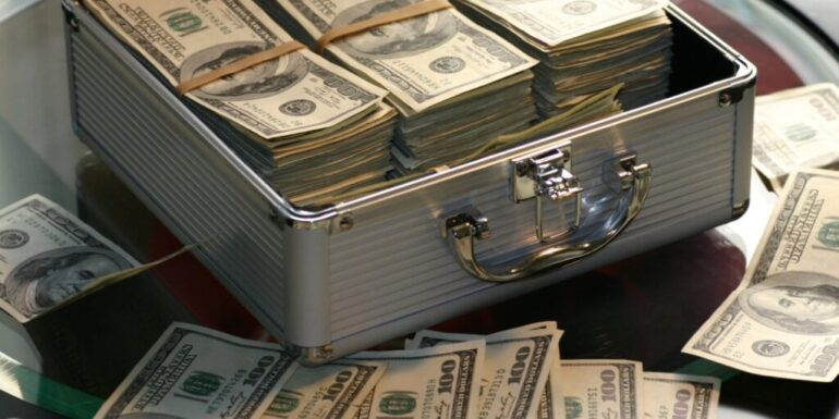 A cash box and money