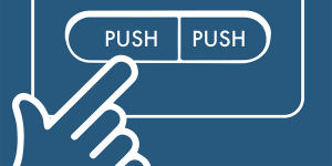 A hand pushing a button.
