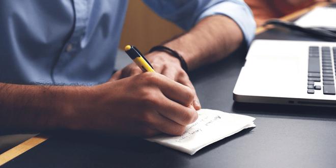 A man writing a list.