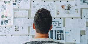A man staring at an idea board.