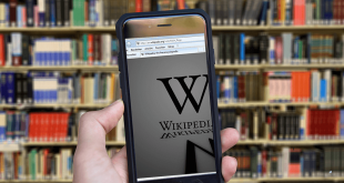 A smartphone displaying the Wikipedia logo.