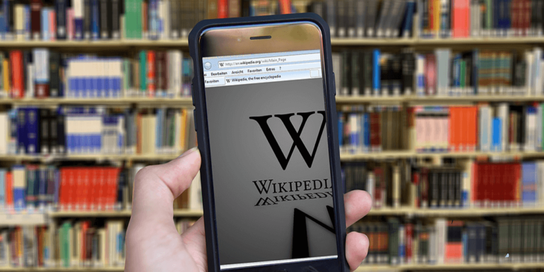 A smartphone displaying the Wikipedia logo.