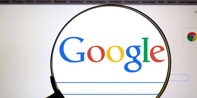A magnifying glass over the Google homepage.