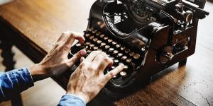 A man working on a typewriter.