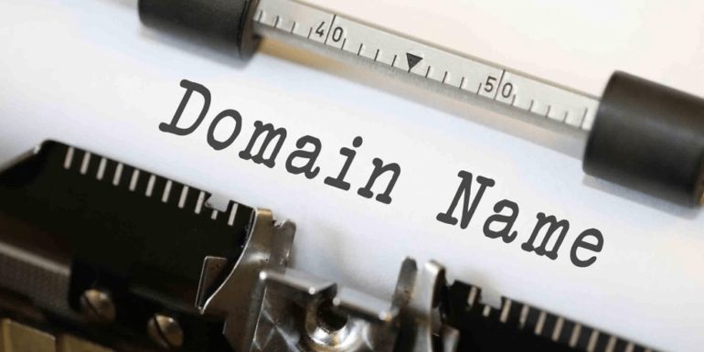 """A typewriter with the words """"domain name""""."""