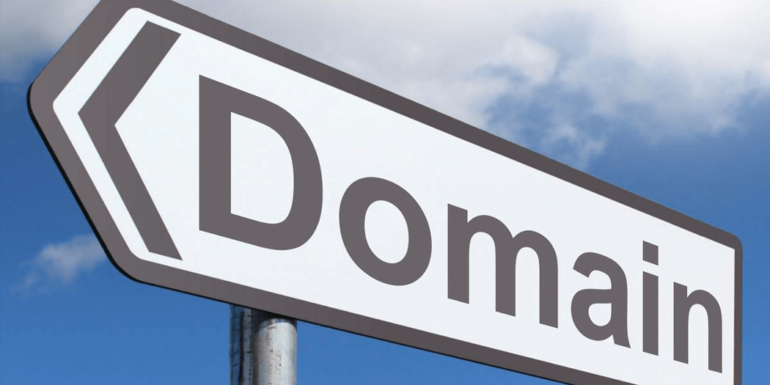 """A street sign with the word """"domain""""."""