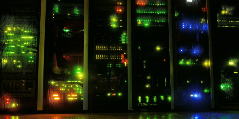A line of servers in a dark room.