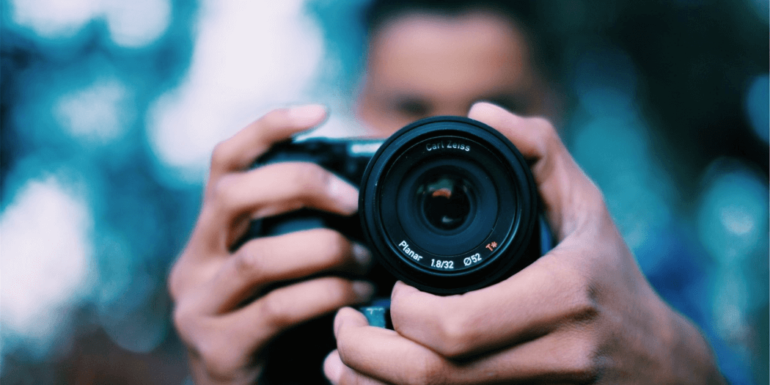 A man holding a camera.