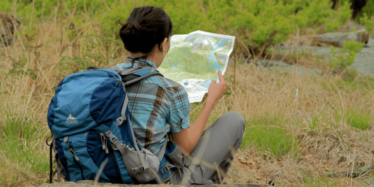 A woman with a map.