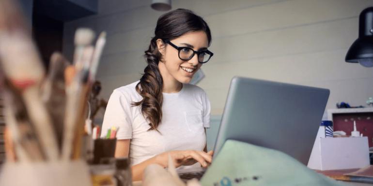 A woman on a laptop.