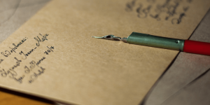 A pen and a letter.