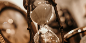 An hourglass with a wooden frame.