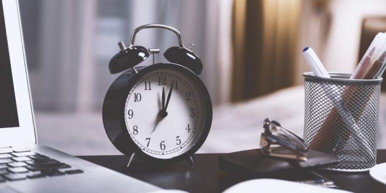 An alarm clock on a desk.