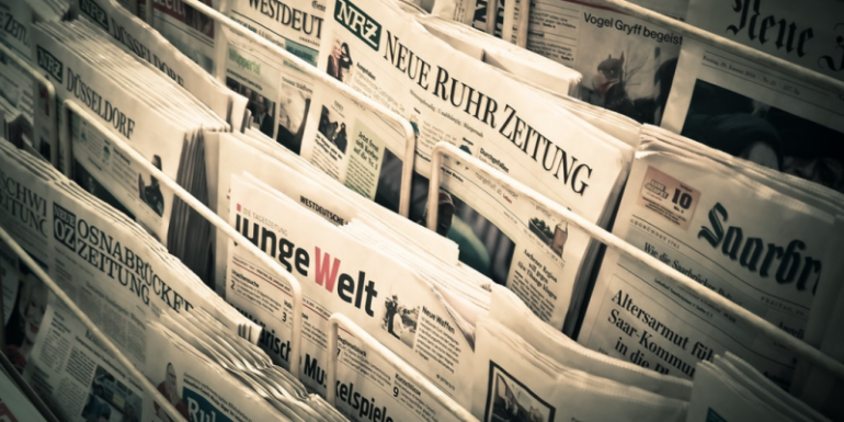 A rack of newspapers.