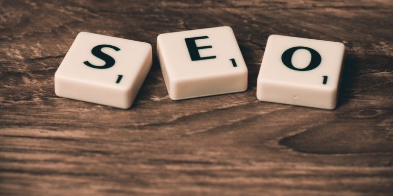 """""""SEO"""" spelled out with Scrabble tiles."""