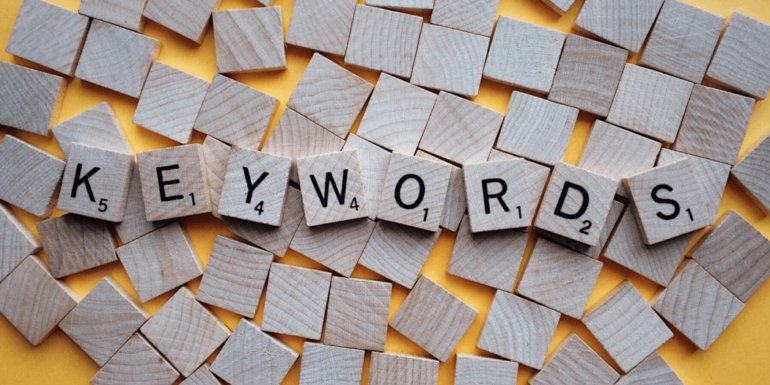 """Scrabble letters spelling out """"keywords""""."""