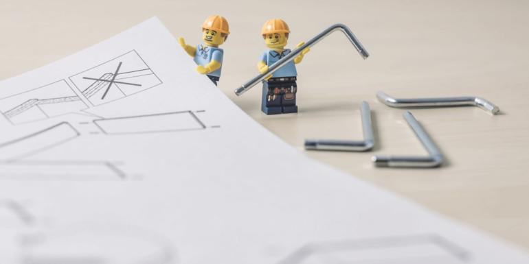 Lego figures with a framework.