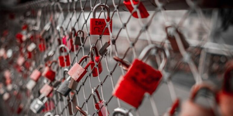 A fence covered in locks.