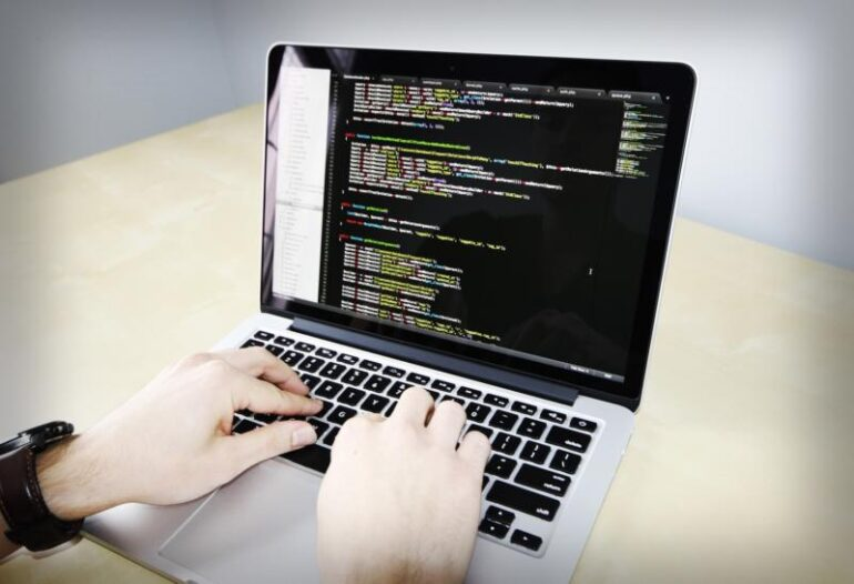Coding on a computer.