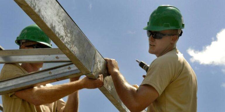 Men building a house.
