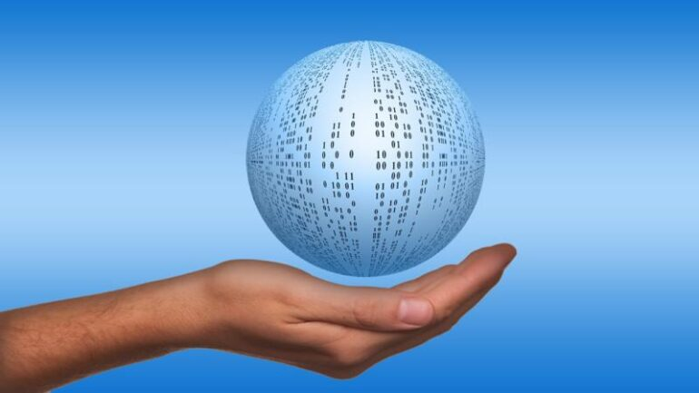 A hand holding a hovering sphere covered in zeros and ones.