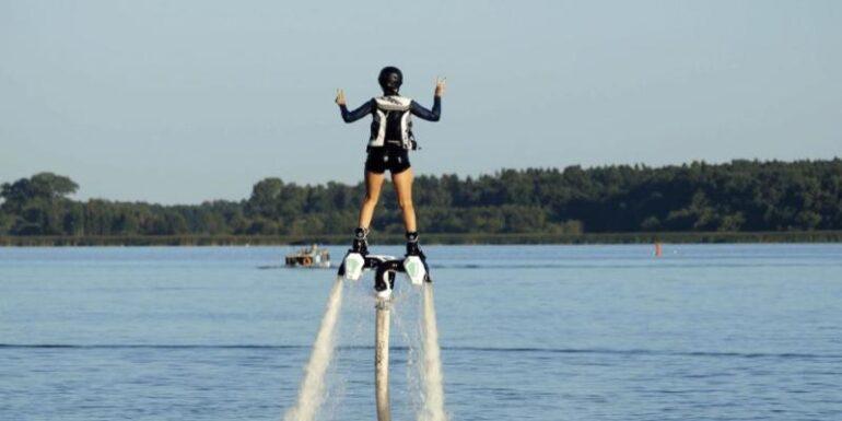 A man riding a jet pack.