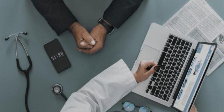A doctor diagnosing a website.