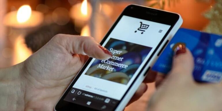 A person using a smartphone to buy products online.