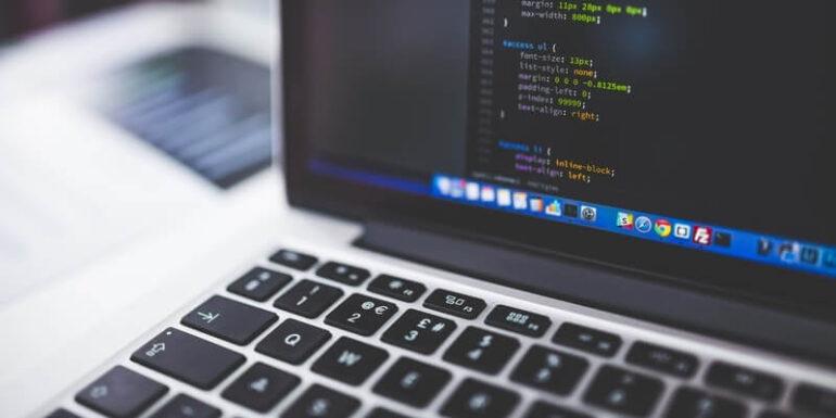 A laptop displaying some code.