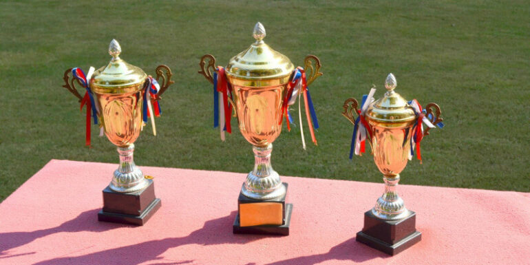 First, second, and third-place trophies.