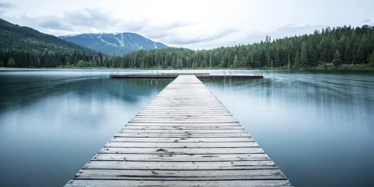 A dock stretching out into open water.