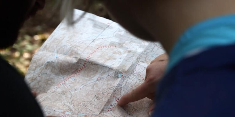 A person pointing to a map.