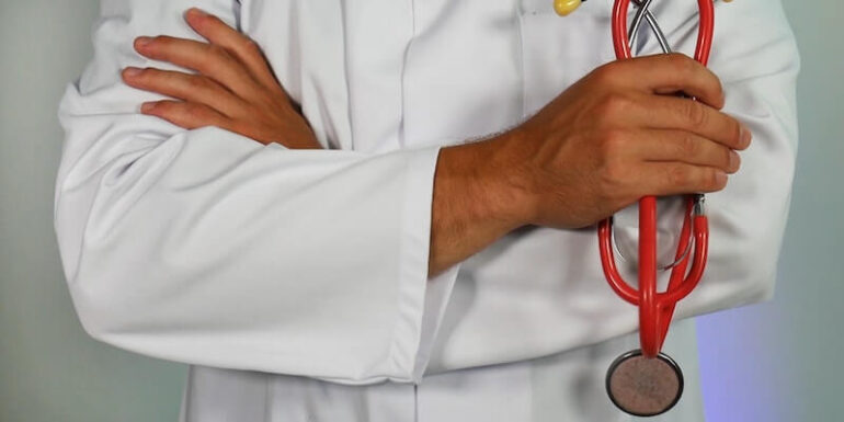 A doctor holding a stethoscope.