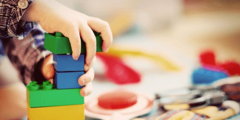 A child building with blocks.