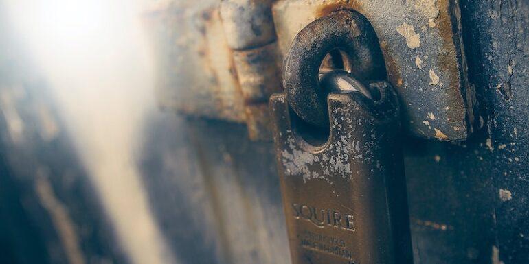 A padlock on a door.