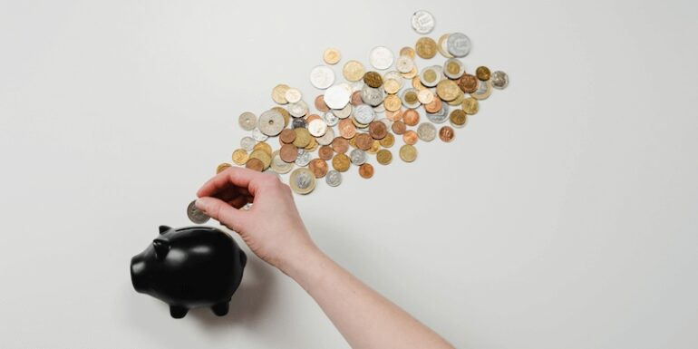 A piggybank with coins.