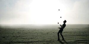 A figure juggling.